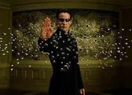 Neo en la película parando balas con se barrera.