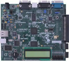 Placa FPGA con display y varias conexiones.